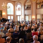 Patrons enjoy the concert in the Grand Parlor at the Ellison Bay Mansion